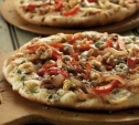 Image of Vegetarian Pizzas with Caramelized Onions, Peppers, and Blue Cheese