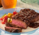 Image of Strip Steaks with Bourbon-Molasses Barbecue Sauce