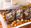 Image of Rib Eyes with Horseradish Butter and Dijon Sweet Potatoes
