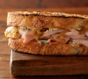 Image of Smoked Turkey Sandwiches with Blue Cheese and Caramelized Onions
