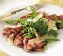 Image of Tagliata of Flank Steak with Arugula and Shaved Parmesan